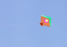 A colorful traditional kite flying in the sky Stock Images