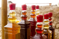 Colorful traditional liquor bottles in rows. Arrangement Stock Image