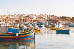 Colorful traditional mediterranean boats, Marsaxlokk, Malta. Stock Photo