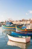 Colorful traditional mediterranean boats, Marsaxlokk, Malta. Royalty Free Stock Photography