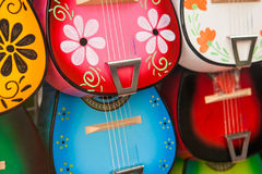 Colorful traditional mexican guitars on market. Great for background Stock Photography
