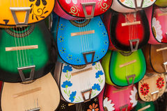 Colorful traditional mexican guitars on market. Great for background Royalty Free Stock Photography