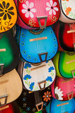 Colorful traditional mexican guitars on market. Great for background Royalty Free Stock Images