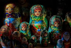 Colorful traditional Russian matryoshka nesting dolls in a souvenir shop in Saint Petersburg Russia with a dramatic high contrast. Display of colorful stock image