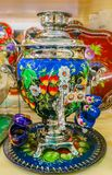Colorful traditional Russian samovar teapot in a souvenir shop in Saint Petersburg Russia. Colorful traditional Russian samovar teapot in a souvenir shop in royalty free stock image
