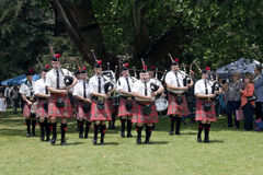 Colorful Traditional Scottish Caledonian Pipe Band Performing Royalty Free Stock Images