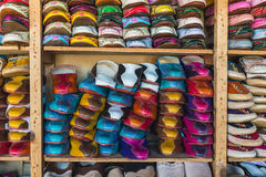 The colorful traditional shoes of Morocco made from leather. Sell in the Medina in Fes, Morocco Stock Photos