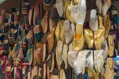 The colorful traditional shoes of Morocco made from leather. Sell in the Medina in Fes, Morocco. For gold and silver shoes made from cloth are bride shoes for Stock Image