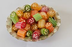 Colorful,traditional Turkish/Ottoman hard candy , feast candy. Colorful,traditional Turkish/Ottoman hard candies in the silver bowl,on the white background.Close royalty free stock photography