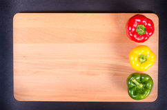 Colorful traffic light paprika on wooden Stock Photos