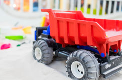 Colorful traffic toy truck in a sand box. Colorful traffic toy truck in a sand box playground Stock Image