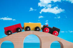 Colorful train toy on wooden bridge with bluesky background Stock Image