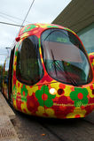 Colorful tram in Montpellier, France. Tramway in Montpellier France with orange flowers decorated  trams Royalty Free Stock Image
