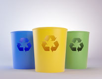 Colorful trash bins with recycling symbols. Three colorful trash bins with recycling symbols Stock Image