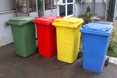 Colorful trash cans. Colorful plastic trash cans the same capacity Royalty Free Stock Photo