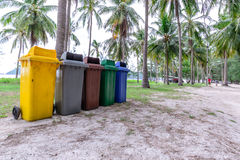 Colorful trashcan at forest seaside.  Stock Image