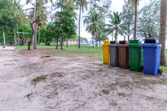 Colorful trashcan at forest seaside.  stock photo