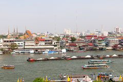 Colorful trasitional river boats crossing the Chao Phraya river Royalty Free Stock Photo