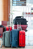 Colorful Travel Suitcases at the Airport Stock Images