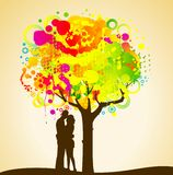 Colorful tree with lovers. Stock Photo