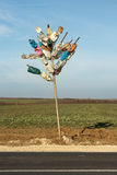Colorful tree from plastic bottles. The idea of recycling and waste reduction. Sratsimir Village, Silistra, Bulgaria - December 10, 2016: Tree made of painted Royalty Free Stock Image