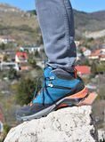 Colorful trekking shoes. With a blurred background stock photography