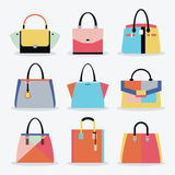 Colorful and trendy women handbags and purse set on white background Stock Photos