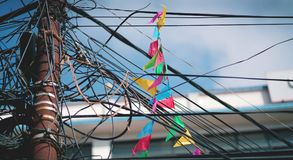 Colorful Triangle Flag on Electrical Wire Cable Tangled and Chao. S at Thamel Street, Kathmandu, Nepal Editorial Royalty Free Stock Images