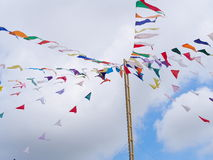 Colorful triangle flags hanging on ropes outdoor Stock Photography