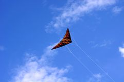 A colorful triangle, textile kite Royalty Free Stock Images