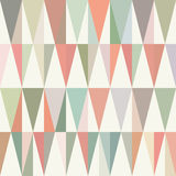 Colorful triangles arranged in a pattern. Pastel hues. Repetitive, seamless template. Royalty Free Stock Image