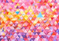 Colorful Triangles Painting. Colorful background created with watercolor featuring a whimsical pattern of triangles Stock Photos