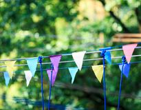 Colorful triangles in the summer park. birthday, party decor royalty free stock photos