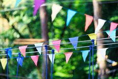 Colorful triangles in the summer park. birthday, party decor royalty free stock image