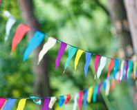 Colorful triangles in the summer park. birthday, party decor royalty free stock images