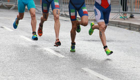 Colorful triathlon feet and legs Royalty Free Stock Photos
