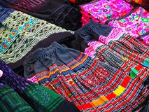 Colorful Tribal Clothing at the Street Market. Closeup image of colorful handmade tribal clothing at the street market royalty free stock photography