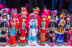 Colorful tribal dolls for sale to the tourist as the souvenir at the local market in Chiang Rai, the northern part of Thailand.  royalty free stock image