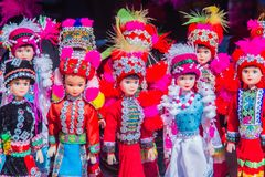 Colorful tribal dolls for sale to the tourist as the souvenir at the local market in Chiang Rai, the northern part of Thailand.  royalty free stock photo