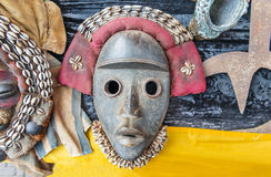 Colorful tribal mask from africa. African tribal masks with a yellow ribbon royalty free stock photos