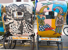 Colorful tricycles or bici-taxis in Camaguey,Cuba Stock Photo