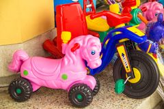 Colorful tricycles. In the market Stock Image