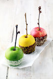 Colorful trio of candied apples for Halloween royalty free stock photos