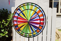 A colorful triple wheel wind spinner Royalty Free Stock Photos