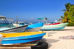 Colorful tropical boats beached in sand Royalty Free Stock Image