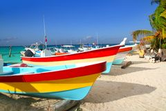 Colorful tropical boats in sand Isla Mujeres. Colorful tropical boats beached in the sand Isla Mujeres Mexico Stock Photography