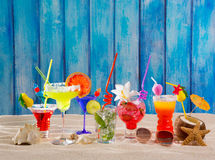 Colorful tropical cocktails at beach on blue wood wall Royalty Free Stock Image