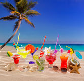 Colorful tropical cocktails at beach on white sand Stock Image
