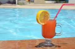 Two Colorful Tropical Cocktails near the Swimming Pool on the Background of Warm Blue Sea. Exotic Summer Vacation. stock photography