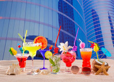 Colorful tropical cocktails in summer at city buildings Royalty Free Stock Photo